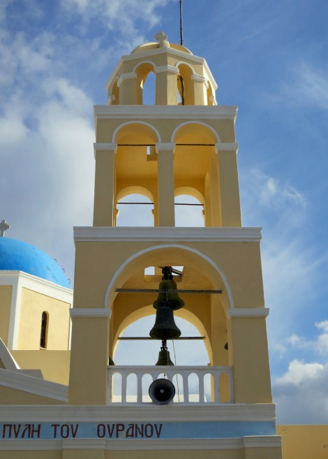 This is a close up of the bell tower on the Church of St. George in Oia, Santorini. The bell towers throught the town were as unique as the churches.